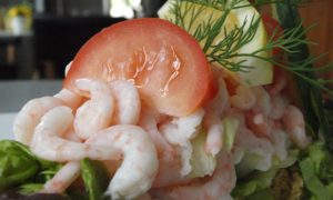 Featured image on marinated shrimp and tomatos
